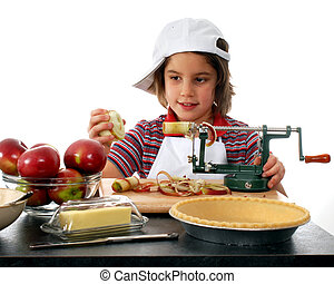 Young Pie Maker - A happy, elementary girl peeling apples...