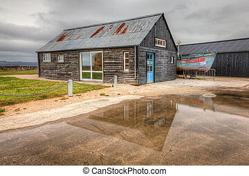Boat House Reflection - Reflection of a boat house in a...
