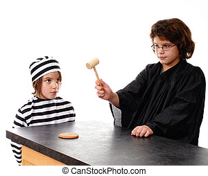Guilty - A robed girl brings down a gavel as her little...