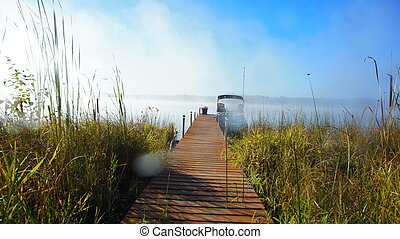 Foggy Morning - Early morning fog lifting over a northern...