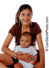 Biracial Siblings - A preteen girl happily holding her baby...