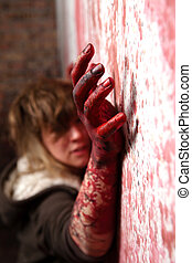 Bloody hand - Spooky bloody hand is trying to catch a wall