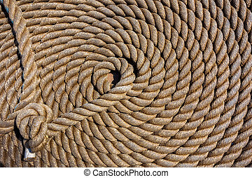 Background deck sailing ship - Thick rope in spiral or ring...