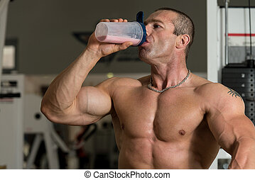 Muscular Man Drinking Water From Shaker - Handsome Muscular...