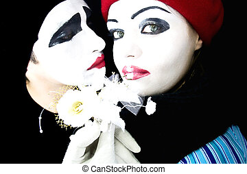mimes with a flower