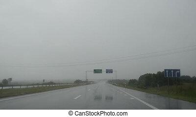 rain fall windscreen car - Driving car on highway road and...