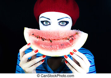 mime with a water-melon piece - Portrait of the mime on a...