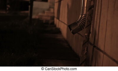 Nighttime Roof Through - Night view of building rain gutter...