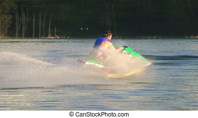 Jet Ski on Lake 02 - Jet ski speeding across lake, audio...