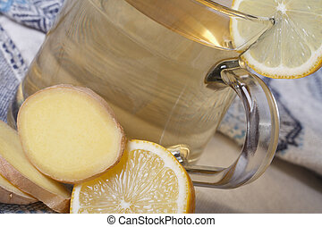 Ginger tea with lemon macro on the table horizontal