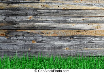 Empty aged wooden surface with grass