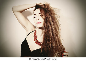 Portrait of a beautiful young woman with long hair
