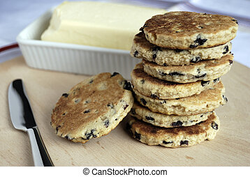 welsh cakes - stack of welsh cakes with out of focus butter...