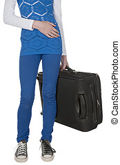 Young woman waist down and her suitcase on isolated white...