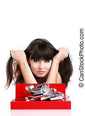 beautiful girl with gift in red box with silver ribbon on white