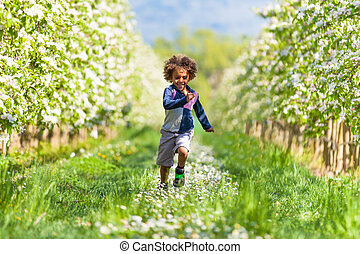 Cute african american little boy playing outdoor - Black...