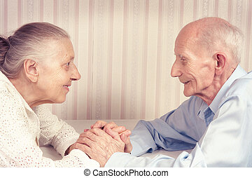 Closeup portrait of smiling elderly couple Old people...