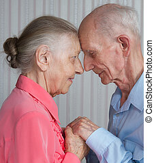 Closeup portrait of smiling elderly couple. Old people...
