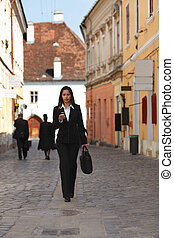 Businesswoman in the city - Businesswoman checking her...