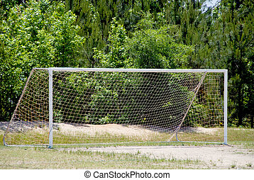 Soccer Goal - A soccer goal set up on a grassy field.