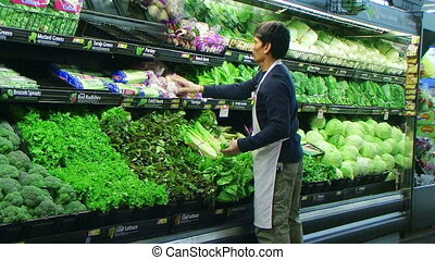 Man Facing Vegetables In Produce
