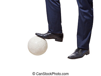 businessman with soccer bal - a young businessman with...
