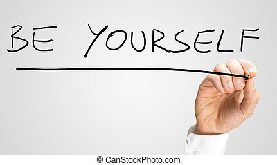 Motivational message - Be Yourself - Close up of the hand of...