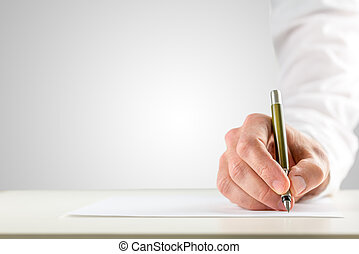 Hand holding a ballpoint in order to start writing -...