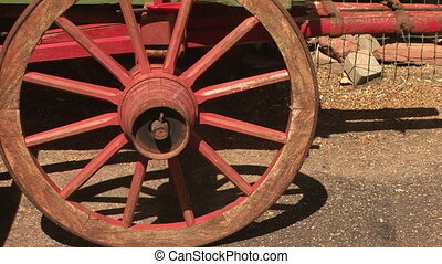 Old Red Wagon Wheel - Zoom in shot of an antique wagon wheel