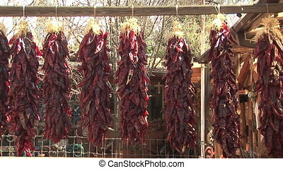 Bunches of Dried Chili Peppers - Zoom in shot of hanging red...