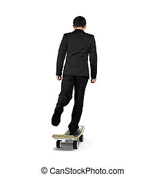 Businessman playing on money skateboard