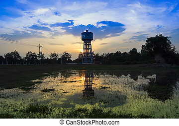 Water Tower at Sunset.