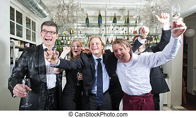 Cheering - Group of friends cheering in a restaurant bar