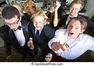 Exuberant Cheering - Group of friends cheering in a...