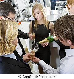 Refilling Champagne - Waiter refilling his guests glasses...