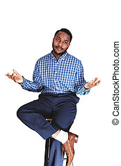 Black man showing - A black young black man sitting isolated...