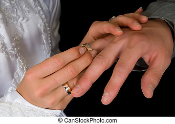 Wedding ring - Young couple putting on wedding ring Black...