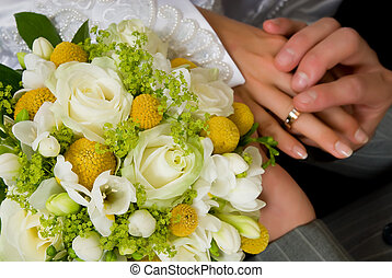 Wedding ring - Young couple putting on wedding ring, bouquet...