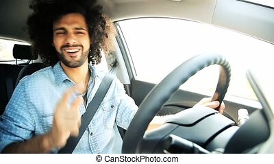 Man dancing and singing driving car