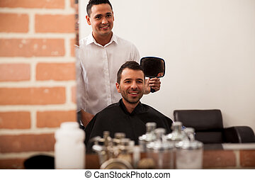 Happy customer in a barber shop - Handsome young man just...