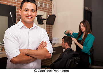 Business owner in his shop - Handsome young barber shop...