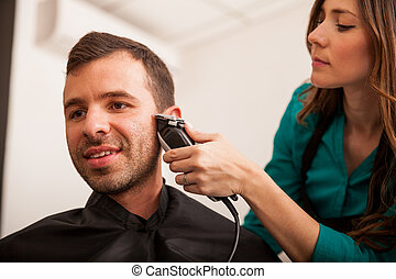Young man in a hair salon - Handsome young man getting his...