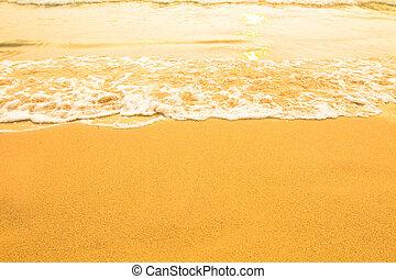 Beach sand texture, soft wave of the sea.