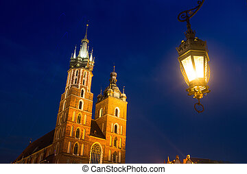 St. Mary's Church on Krakow Market Square in night time.
