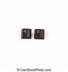 go word written with black computer buttons over white - go...