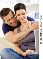 Love couple using laptop computer