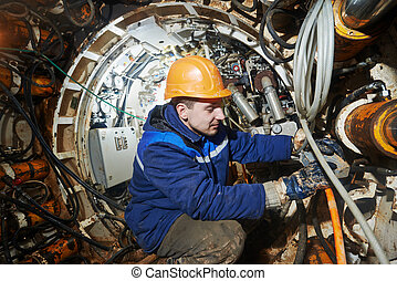 undeground working in tunnel - Tunneller sinker worker...
