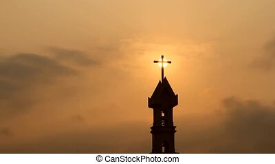 The Risen Christ: sunrise behind Calvary Cross