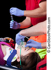 Injured woman - Paramedics with injured woman on a...