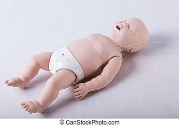 Training infant dummy on white background, horizontal
